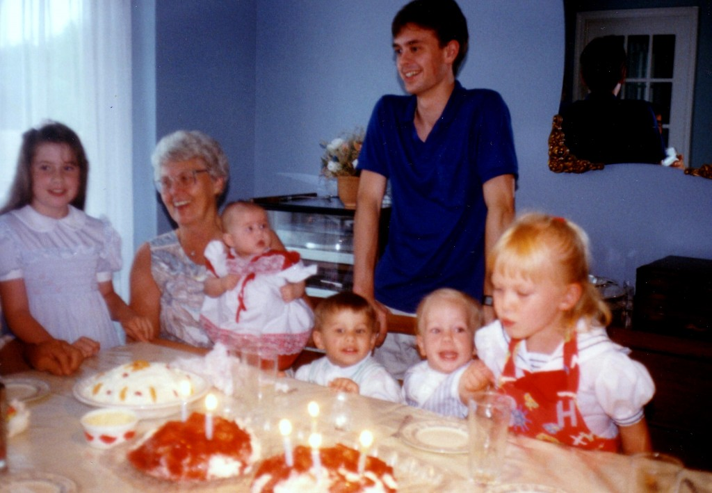 I think we're celebrating Nanny's birthday. L-R: Me, Nanny, Laura, Adam, Steven, Megan. Standing in the back: Keith.